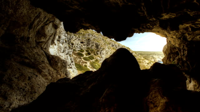 exploring mountain cave. time lapse. - cave stock videos & royalty-free footage