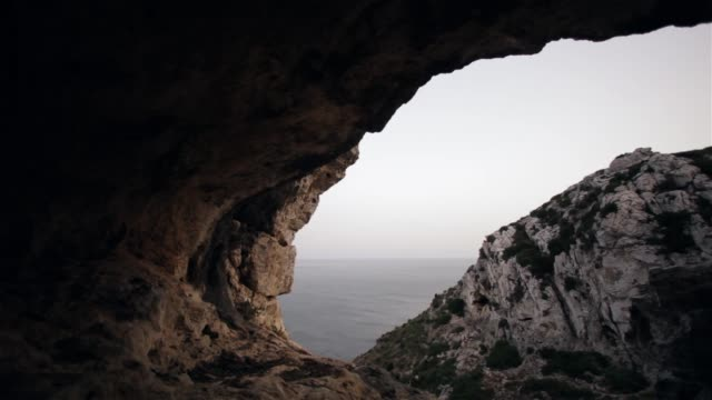 exploring mountain cave - cave stock videos & royalty-free footage