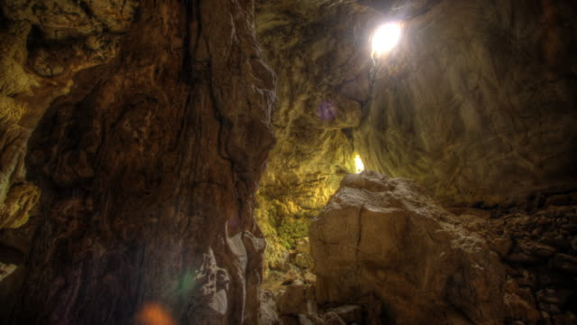 exploring mountain cave - claustrophobia stock videos & royalty-free footage