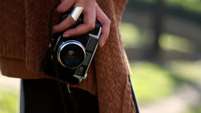 exploring the city with a vintage film camera - slr camera stock videos and b-roll footage
