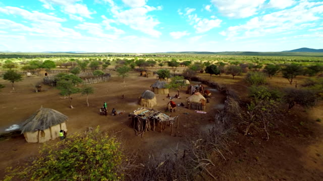 stockvideo's en b-roll-footage met heli exploring the himba village - namibië