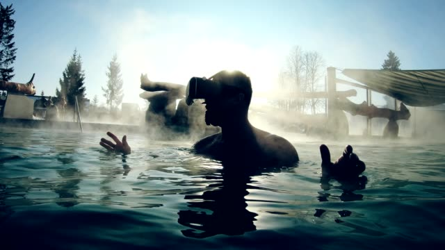exploring virtual reality in geothermal pool - sauna stock videos & royalty-free footage