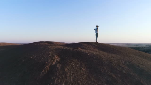 Exploring virtual reality. Man admiring view with open arms