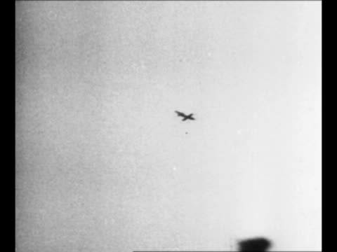 """explosion at front in world war ii / winston churchill confers with officer / german v-1 """"buzz bomb"""" plane flies / churchill at tour of anti-aircraft... - bomb stock videos & royalty-free footage"""
