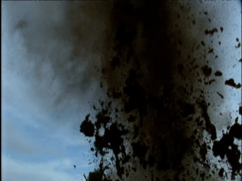 Explosion blasts soil into air debris hits camera