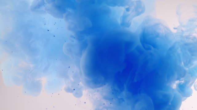 explosion of bright blue ink on a white background - curlicue stock videos & royalty-free footage