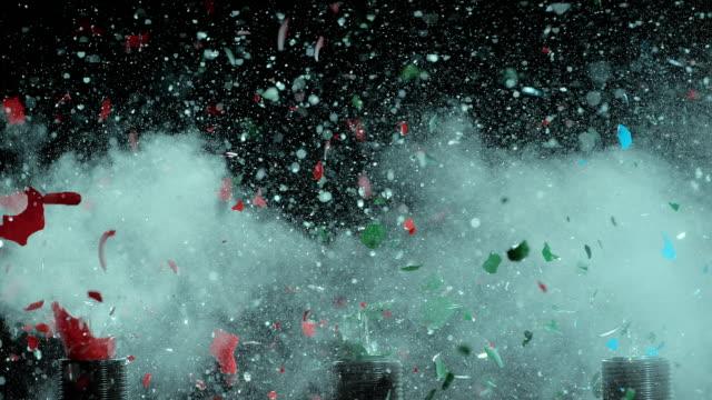 slo mo explosion in rot, grün und blau glühbirnen - aufprall stock-videos und b-roll-filmmaterial