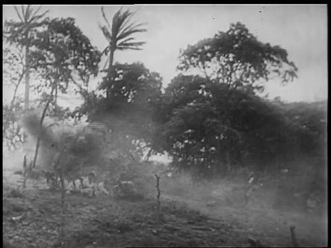 B/W 1898 REENACTMENT explosion on hill in Spanish-American war / documentary