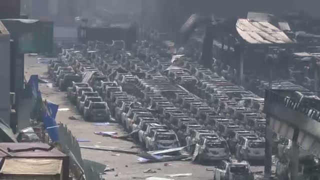 explosions at tianjin port kills dozens shows exterior shots rows of burnt out vehicles at at port warehouse on august 13 2015 in tianjin china - tianjin bildbanksvideor och videomaterial från bakom kulisserna