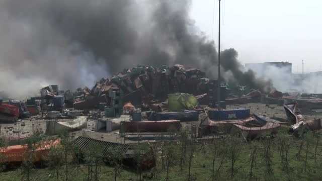explosions at tianjin port kills dozens shows exterior shots destroyed shipping containers smoke rising at the scene on august 13 2015 in tianjin... - tianjin bildbanksvideor och videomaterial från bakom kulisserna