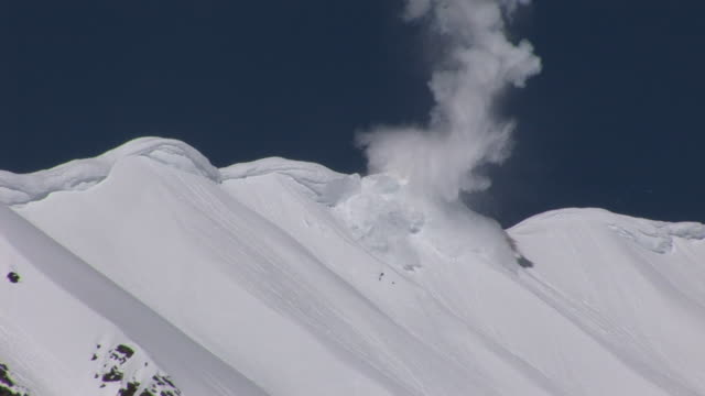 explosive charges trigger mountain avalanches. - explosive stock videos & royalty-free footage