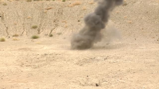 Explosive ordinance disposal soldiers from the Afghan National Army perform their first live detonations using C4