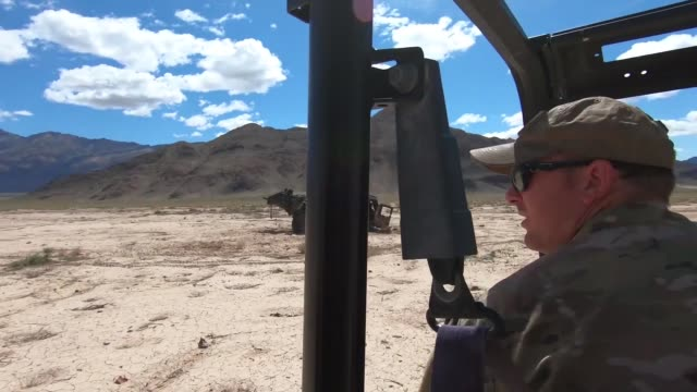 explosive ordnance disposal airmen conduct range clearance operations on the nevada test and training range nevada - 迫撃砲点の映像素材/bロール