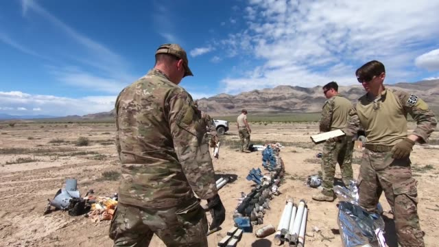 explosive ordnance disposal airmen conduct range clearance operations on the nevada test and training range, nevada. - gunpowder explosive material stock videos & royalty-free footage