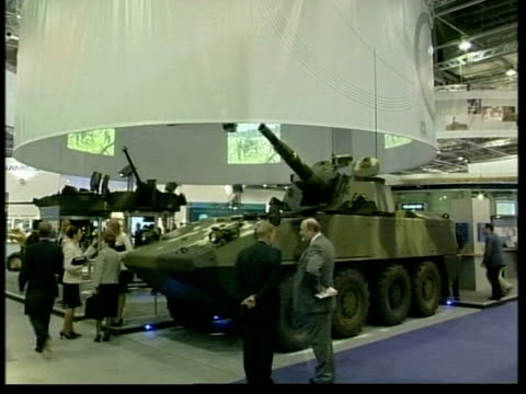 export credit guarantee department under fire:; itn lib gvs at arms fair with people looking at weapons - waffe stock-videos und b-roll-filmmaterial