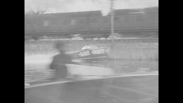 express train flying scotsman moves on track along the river great ouse in huntingdon england / cu speedboat racer/dart boat dealer j w shillan with... - zug mit dampflokomotive stock-videos und b-roll-filmmaterial