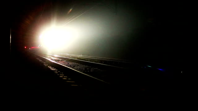express train moving forward at night - train stock videos & royalty-free footage