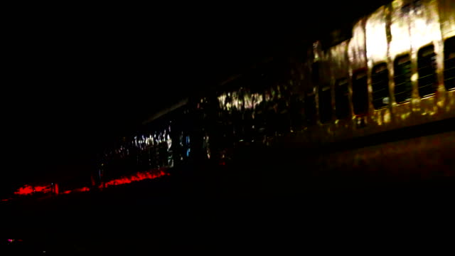 express train passing through railroad station at night - station stock videos & royalty-free footage