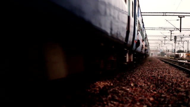 express train running on railroad track - rail transportation stock videos & royalty-free footage