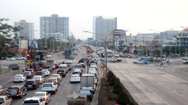 express way with high building in evening , chiang mai city, thailand - chiang mai city stock videos and b-roll footage