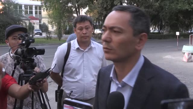 ex-prime minister of kyrgyzstan omurbek babanov speaks to the press on august 20, 2019 in bishkek after he came to the state committee for national... - criminal stock videos & royalty-free footage