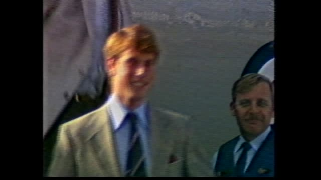 stockvideo's en b-roll-footage met ext armidale airport with union jack flying / people waiting / prince edward off plane greets prince's' old tutor jim graham / tarmac walk / man with... - rugby sport