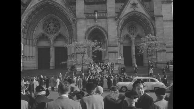 stockvideo's en b-roll-footage met ext cathedral of st john the divine / front facade of cathedral / interior of church as the queen mother is escorted up aisle wearing a cap and gold... - afstudeer toga