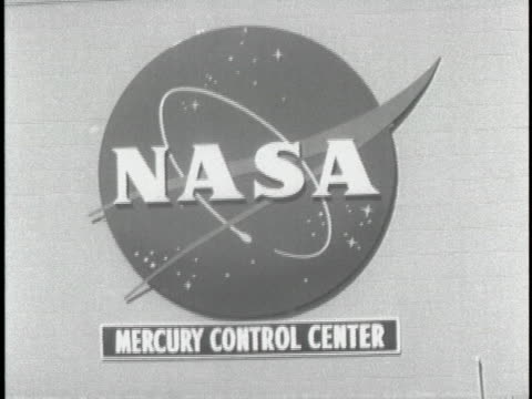ext. shot off sticks of the entrance of the nasa mercury control center. there are palm trees around and the entrance is heavily crowded. a car is... - alan b. shepard jr stock videos & royalty-free footage