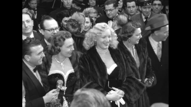Ext theater surrounded by celebrities ABC host Dennis James with Jane Pickens and unidentified blond actress one walks off camera