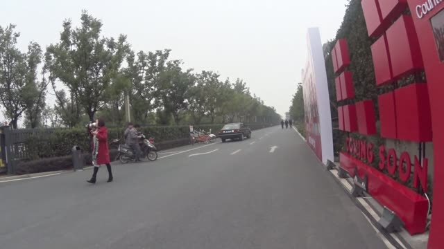 Exteior shots of the Alibaba offices taken from bikes in Hangzhou China on Wide shots of various paths outside various office buildings