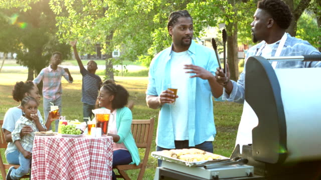 extended african-american family having cookout - aunt stock videos & royalty-free footage