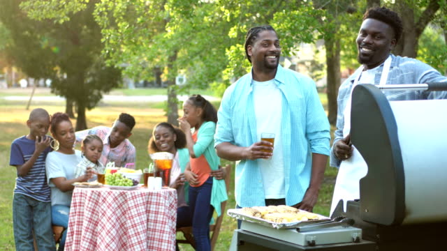 Extended African-American family having cookout
