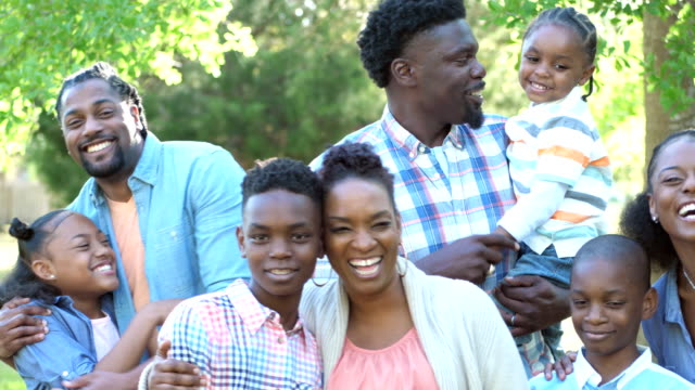 extended african-american family laughing together - large family stock videos & royalty-free footage