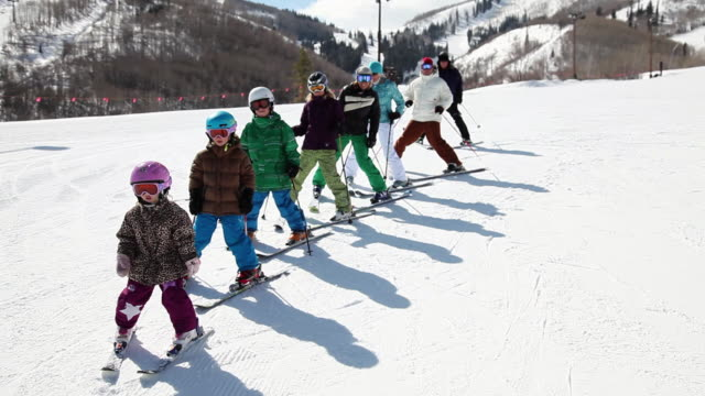 ms pan extended family, children, parents, grandparents, skiing in row down mountain / park city, utah, united states - kids in a row stock videos & royalty-free footage