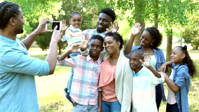 extended family photo, waving at photographer - big family stock videos & royalty-free footage