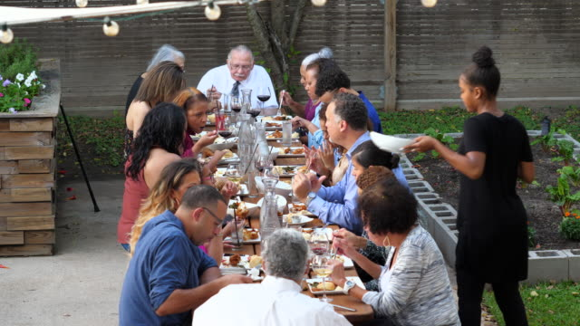 ms extended family sharing celebration meal on outdoor patio - big family stock videos & royalty-free footage