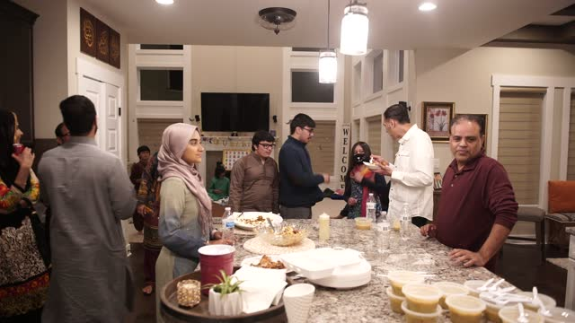 extended muslim families chat as they enjoy an iftar meal on april 16, 2021 in hilliard, ohio. normally they would pray at the local islamic center,... - mosque stock videos & royalty-free footage