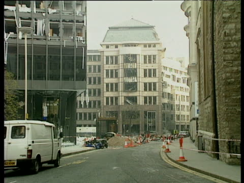 extensive damage caused to city of london office blocks by ira bomb attack at baltic exchange; 11 apr 92 - bomb stock videos & royalty-free footage