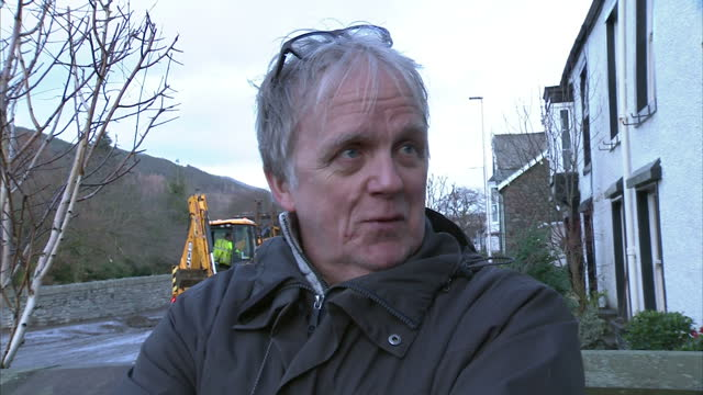 extensive flooding across the north west of england shows exterior shot roger scoon resident talk about how flooding has been the worst he has seen... - cumbria stock-videos und b-roll-filmmaterial