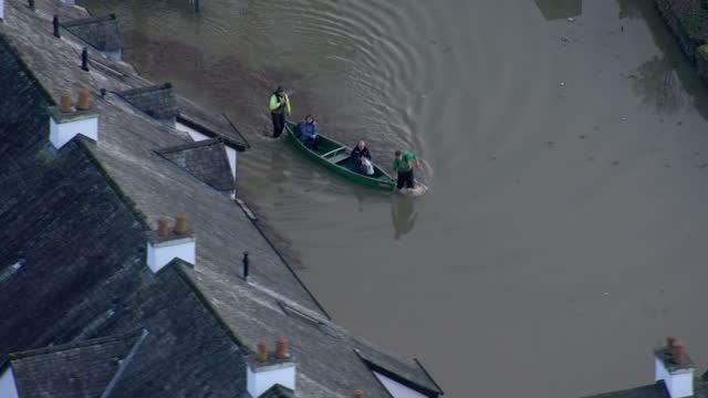 Extensive flooding in the North West of England Shows exterior shots aerials people using boat to get around on December 06 2015 in Keswick England