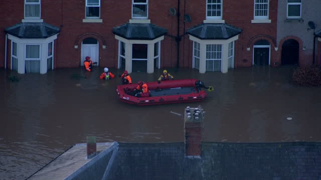 extensive flooding in the north west of england shows exterior shots aerials flooding in carlisle rescue dinghy out helping people outside their... - cumbria stock videos & royalty-free footage
