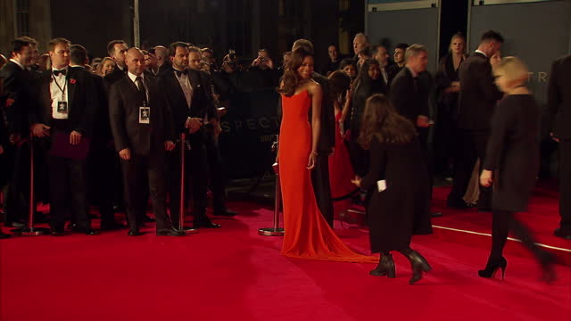 exterio shots of naomie harris attending the royal world premiere of 'spectre' at royal albert hall on october 26 2015 in london england - spectre 2015 film stock videos and b-roll footage