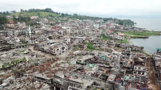 Exterior 4K drone aerial footage of the devastated city of Marawi after its liberation from Islamic State with various buildings damaged in fighting...