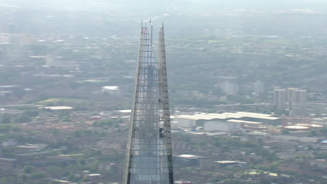 exterior aerial 360 degrees close up of the top of the shard building in central london the shard close up aerial views london on july 11 2013 in... - shard london bridge stock videos & royalty-free footage