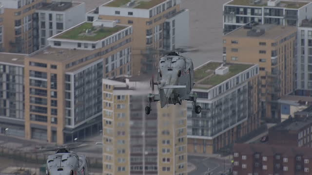 Exterior aerial airtoair shots of Royal Navy Lynx helicopters flying over London on 17 March 2017 in London United Kingdom