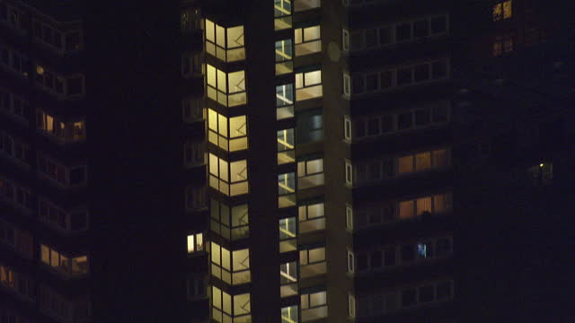 exterior aerial night shots council estate tower blocks and blocks of flats with lights on in buildings on october 27 2016 in london england - blocking stock videos and b-roll footage