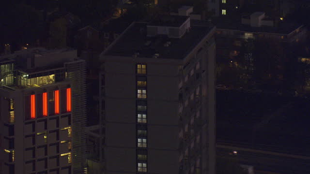 exterior aerial night shots council estate tower blocks blocks of flats with lights on in buildings on october 27 2016 in london england - blocking stock videos and b-roll footage
