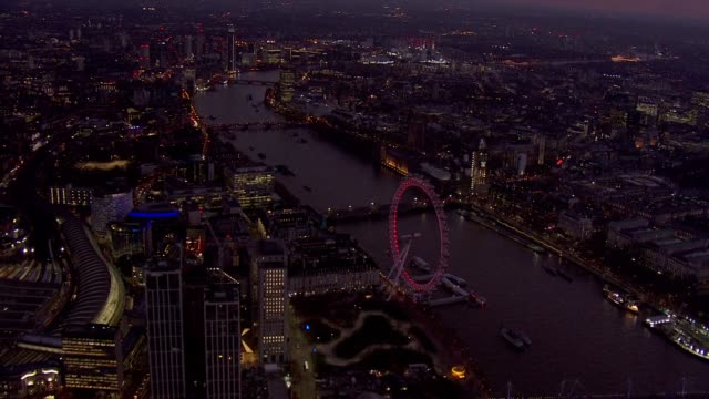 exterior aerial night views of the palace of westminster the london eye and the river thames as indicative votes take place in the house of commons... - night stock videos & royalty-free footage