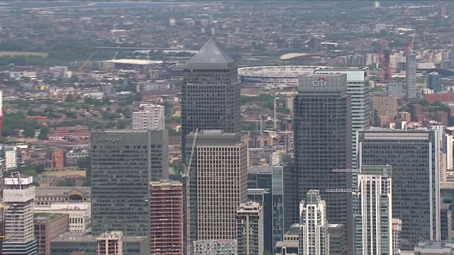 Exterior aerial panning shots of the City of London and The River Thames including JP Morgan building CTI Building HSBC tower Canary Wharf Olympic...