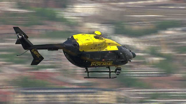 exterior aerial shot metropolitan police helicopter flying over london on 11th june 2014 in london england - 警視庁点の映像素材/bロール